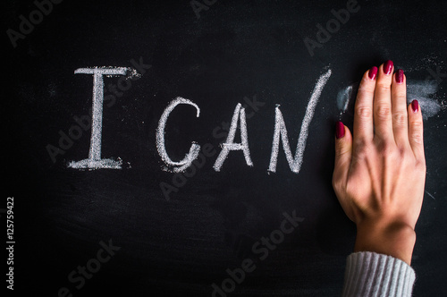 """Poster The inscription """"I can't"""" on the board, the hand closes the letter """"T"""""""