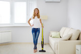Girl with wireless vacuum cleaner - 125783622