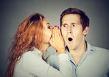 amazed shocked man listening gossip in the ear