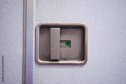 Poster Airplane compartment door closed and locked position.