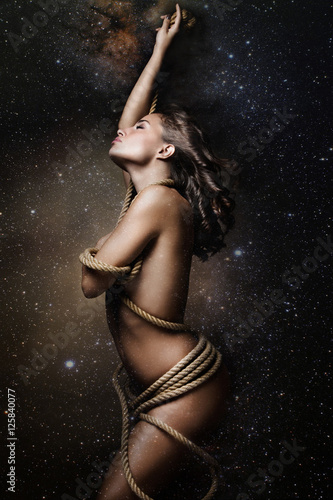 Fototapeta young woman wrapped in rope