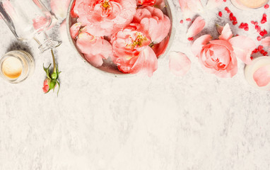 Spa background with roses , bowl with water and petal and cream, top view, border