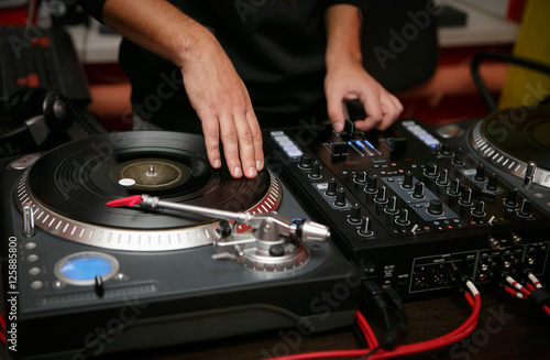 Poster Hip hop DJ scratch vinyl records on turntable player