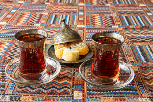 Poster Traditional Turkish tea on the colored tablecloth
