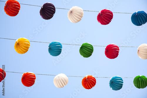 multiples guirnaldas con farolillos de colores en la feria de Málaga en España Poster