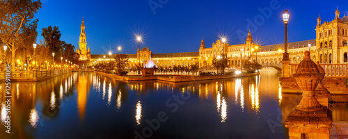 Panorama of Spain Square or Plaza de Espana in Seville at night, Andalusia, Spain