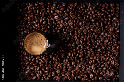 Poster espresso coffee on coffee beans background