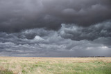 The sky turns dark and turbulent as a storm approaches in the high plains of eastern Colorado. - 125913816