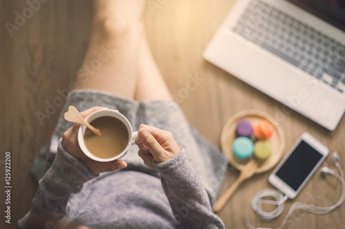 Young woman relaxing at cozy home atmosphere