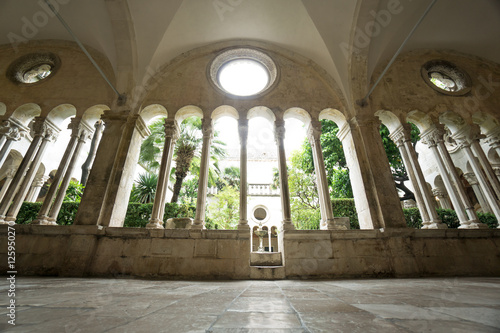 The columns, hallways and cloister of the Franciscan Monastery in Dubrovnik, Croatia Poster