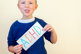 Fototapety Young boy hold ADHD text