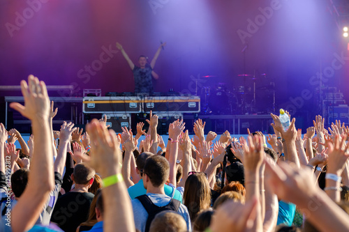 Poster Crowd of fans cheering at open air live music festival