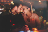 Fototapety Romantic couple dating in pub