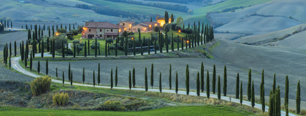 long road with cypress to old villa in Tuscany