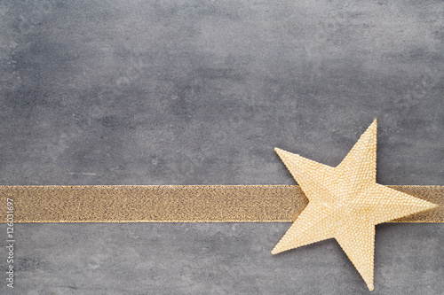 Poster Christmas stars. Christmas pattern. Background on the gray color