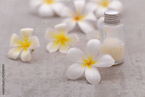 Poster Spa Spa stone with frangipani ,massage oil on grey background.