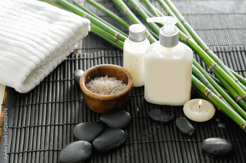 Poster Spa towel and stones and oil,grove on bamboo mat