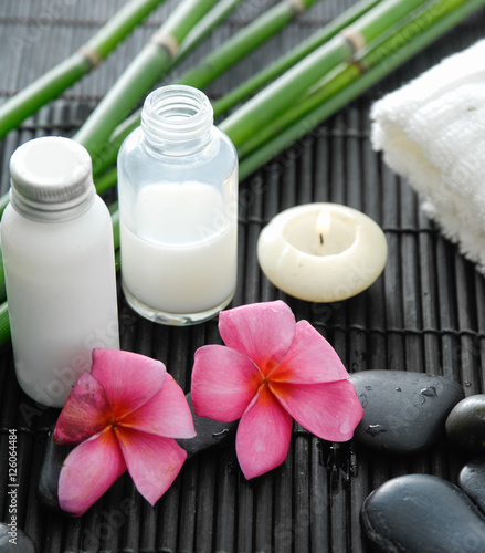 Poster Spa White towel and stones and oil, grove, frangipani on bamboo mat