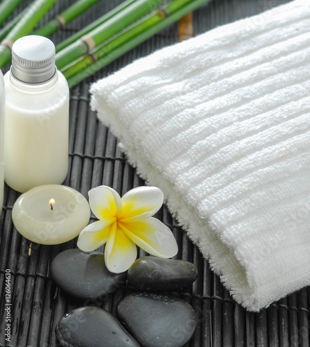 Poster Spa White towel and stones and flower ,grove on bamboo mat