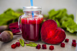 Beetroot juice in a mason jar mug on grey stone background. Detox and healthy diet.