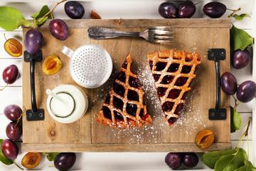 Plum tart, milk and fresh plums