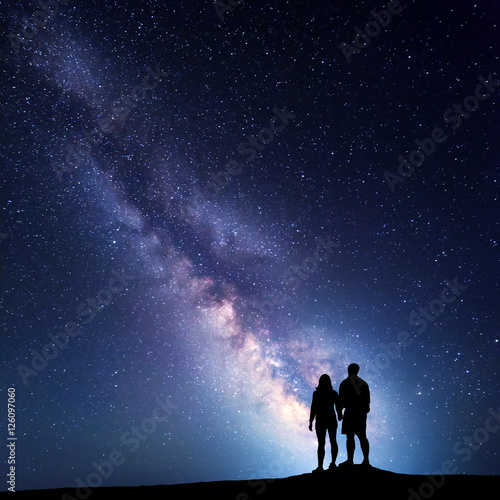 Poster Milky Way with people on the mountain