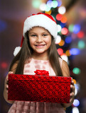 Little girl holding a Christmas present