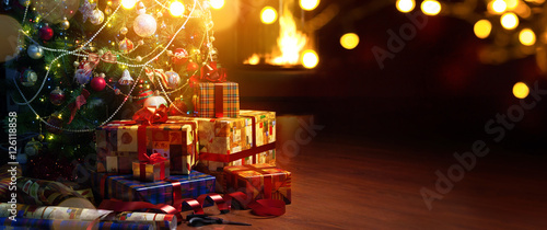 Christmas tree and holidays present on fireplace background - 126118858