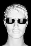 white mannequin with sunglasses, on black background