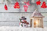 Fototapety Burning lantern and christmas decoration on wood