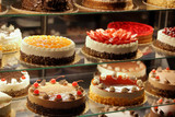 Fototapety Different types of cakes in pastry shop glass display