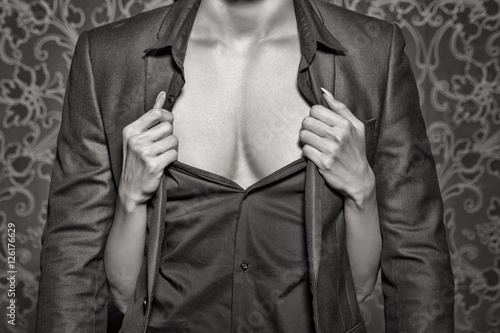 Woman hands undress rich man closeup black and white Poster