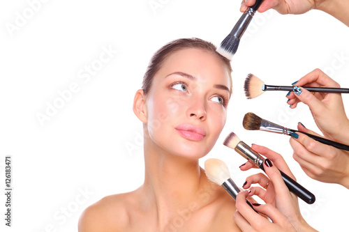 Poster Young woman with make up brush, isolated on white background