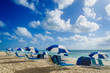 Beach umbrellas at morning Miami beach