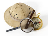 Explorer hat, magnifying glass and vintage compass.. 3D illustration