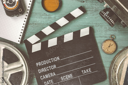 Clapperboard and a film reel