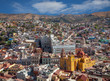 Colorful Buildings and Cathedral in City of Guanajuato from Mexico Against Cloudy Blue Sky