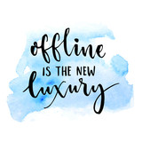 Offline is the new luxury. Inspirational saying about internet and social media. Vector typography on blue watercolor swash.