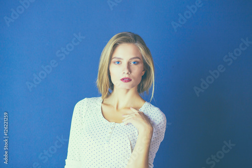 Poster Portrait of woman with arms crossed, isolated on white background