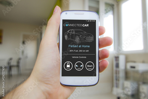 Poster Hand holding smartphone with connected smart car app on the screen