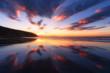 Barinatxe beach with cloud reflections at sunset