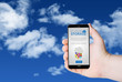 Hand hold a phone with cloud storage on a screen