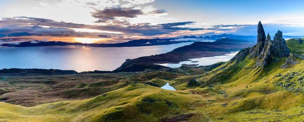 Sunrise at the most popular location on the Isle of Skye - The Old Man of Storr - beautiful panorama of an amazing scenery with vivid colors and picturesque panorama - symbolic tourist attraction © photoenthusiast