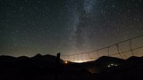 Starry night sky with milky way galaxy time lapse. Dolly shot over fence