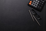 Office leather desk table with calculator, pen and pencil