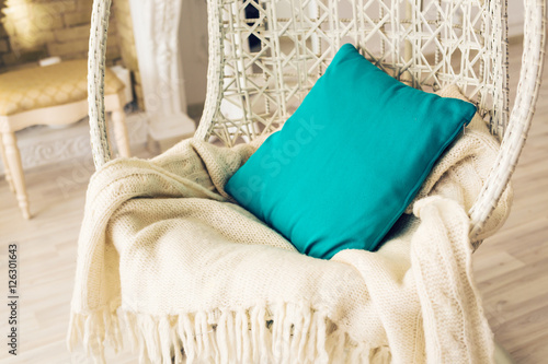 Poster Stylish armchair with pillow and knitted plaid