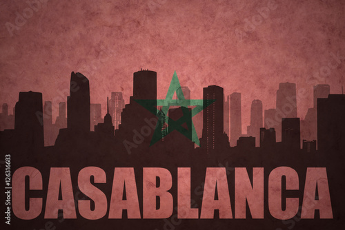 abstract silhouette of the city with text Casablanca at the vintage moroccan fla Poster