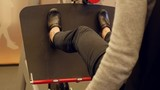 Woman uses leg press for physical therapy