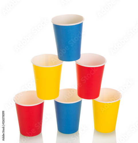 Pyramid of colorful disposable paper cups isolated on white.