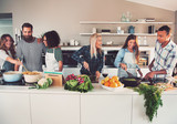 Fototapety Six mixed Black and Caucasian friends cooking food
